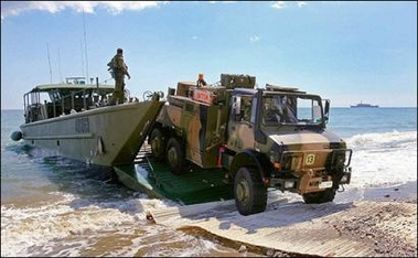 Several hundred Australian commandos land in the tiny Pacific Ocean nation of East Timor in an effort to quell escalating fighting between the military and dissident armed forces