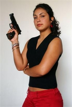 The latest scandal swirling around President Alejandro Toledo involves Lt. Lady Bardales, an attractive 23-year-old policewoman who posed on the cover of Peru's leading news magazine in a black sleeveless sweater and tight red jeans with her midriff exposed and 9 mm pistol drawn.