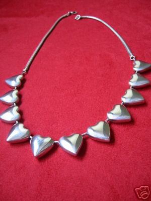Sterling Hearts, Unique Peace Corps Designer Necklace. Bayanihan was founded in 1974 by W. Thomas Burns as an outgrowth of his Peace Corps experience in the Philippines. Bayanihan means working together