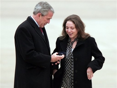 Bush takes a moment to honor Peace Corps volunteer Lydia Humenycky