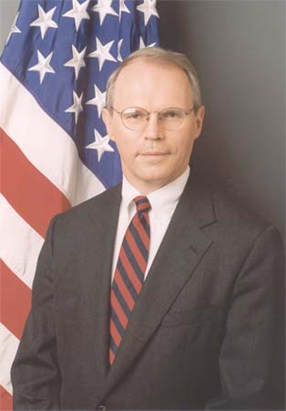 President Bush has approved the selection of Christopher R. Hill, the envoy to the North Korea talks, for the grade of career minister