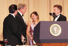 President George W. Bush congratulates Mei-Ling Hopgood and Russell Carollo of the Dayton Daily News. Hopgood and Carollo were the lead writers on a seven-day series that won the Edgar A. Poe award for 2004