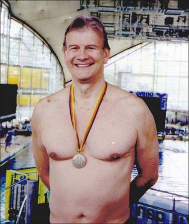 67-year-old Jamaica RPCV David McIntyre captures medals on land, in water