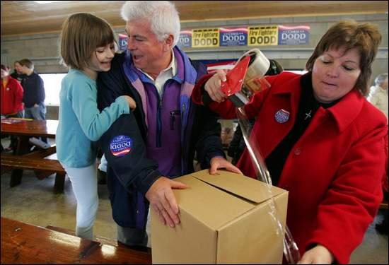 Chris Dodd played Santa on a Christmas Eve visit here, filling boxes of goodies for shipment to Iowa soldiers in Iraq and Afghanistan
