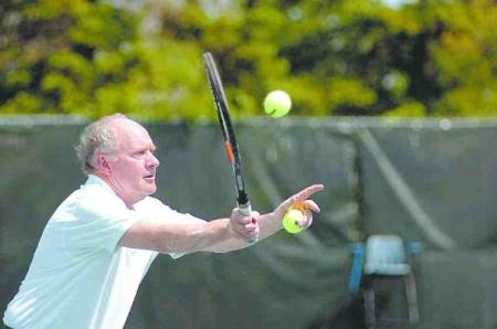 India RPCV Don Axtell has the tennis court covered