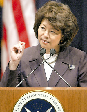 John Cheaves writes: Chao attends her husband's fund-raisers, chats with his donors and seeds her agency with his former aides