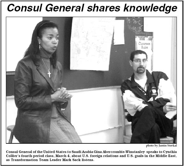 Consul General of the United States to Saudi Arabia Gina Abercrombie-Winstanley speaks to Cynthia Collier's fourth period class, March 4, 2004, about US foreign relations and US goals in the Middle East as Transformation Team Leader Mark Sack listens