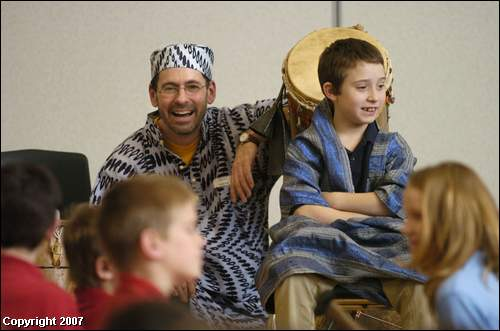 When Togo RPCV Gregory Acker played African drums with a group of fourth- and fifth-grade students during an assembly, the students couldn't stop moving