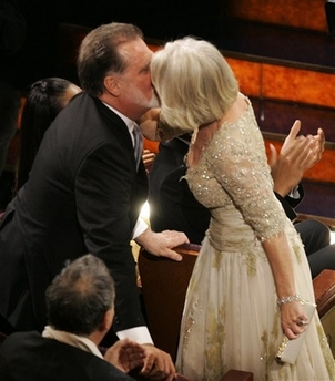 British actress Helen Mirren is congratulated by husband, Taylor Hackford, after winning the Oscar for best actress for her work in 'The Queen' the 79th Academy Awards
