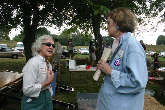Deputy Peace Corps Director Jody Olsen (right)  spoke at the group's Picnic in 2005.  Here she is talking to one of the members of the group, Lane Berk, about the Peace Corps Military Option that was being much discussed at the time. Members of the Maryland Returned Volunteers lobbied Congress to change the law - a change that was signed into law this past January.