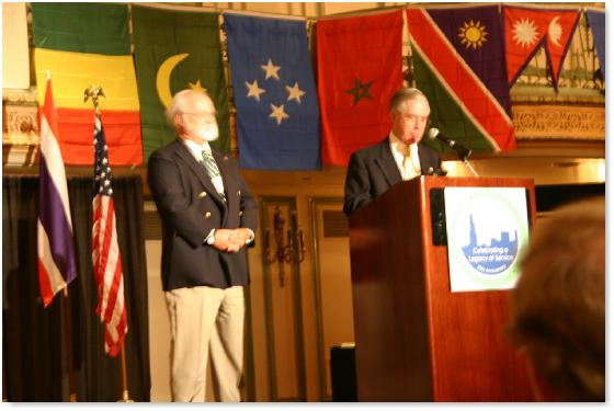 Former Peace Corps Director Nick Craw presents Shriver Award