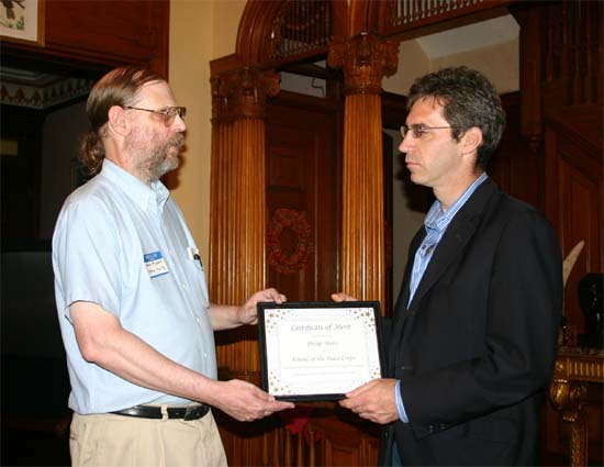 Hugh Pickens, Publisher and co-editor of Peace Corps Online, presents a certificate to Phil Weiss thanking him for his service to the Returned Volunteer community.