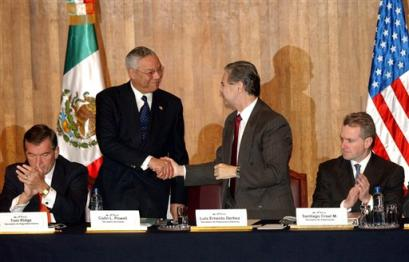 Colin Powell and Tom Ridge are in Mexico accompanied by Interior Secretary Gale Norton, Transportation Secretary Norman Mineta, Housing and Urban Development Secretary Alphonso Jackson, and Peace Corps Director Gaddi Vasquez