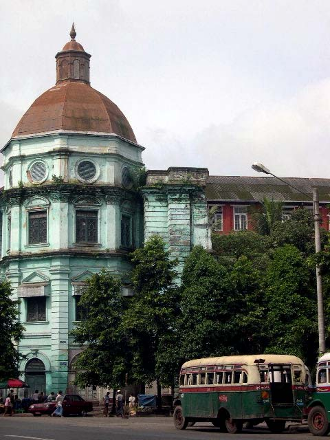 Paul Theroux writes: The decrepitude of the buildings in Rangoon is almost grand