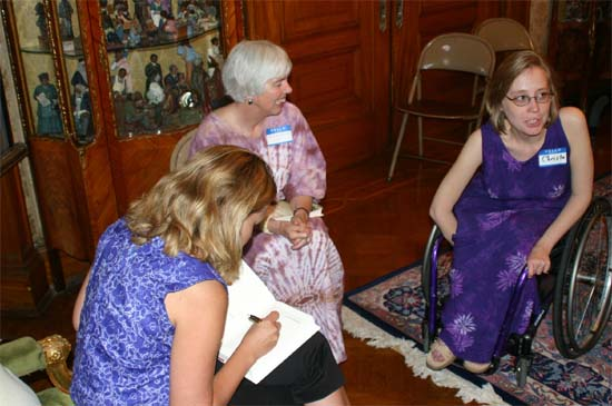 "RPCV Author Sarah Erdman talks about her book ""Nine Hills to Nambonkaha"" at the group's Book Club Meeting in 2004 that was held in a Victorian brownstone in Reservoir Hill. Here Sarah (left) talks with members Kay Muldoon-Ibrahim and Christa Bucks-Camacho."