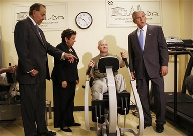 Shalala tours veterans center with Bush