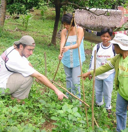 Shawn Doland works with Phillippine locals to teach them about soil erosion and prevention in their farming fields while serving with the Peace Corps