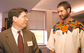 Mark D. Gearan, left, national director of the Peace Corps, speaks with Cameroon RPCV Stefan Cherry, Peace Corps coordinator at Cornell and graduate student in international agriculture, during ceremonies in Day Hall April 30