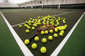 MacMurray College men&#39;s tennis team is banned from outside competition for two years after Antigua RPCV Neal Hart arranged a scholarship fund for international student-athletes.  Hart said he helped bring in students from Argentina, Ghana and Kenya among other countries. We didn&#39;t do anything wrong, and I would do it again in a minute if I can help kids
