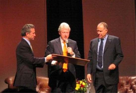 Thomas Tighe moderates discussion of NGO's with Bill Clinton and Paul Orfalea in Santa Barbara