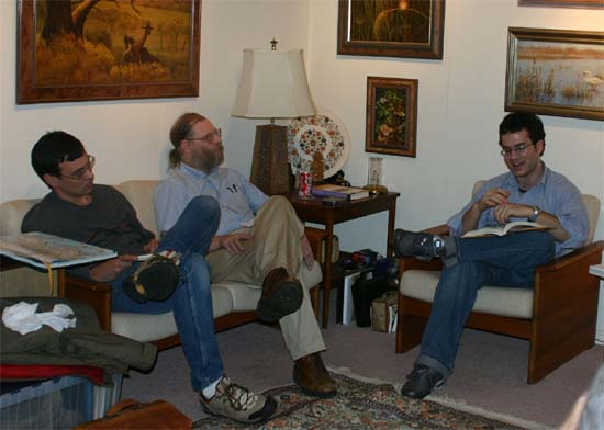 "RPCV Author Tom Bissell (right) talks about his book, ""Chasing the Sea,"" at the group's Book Club Meeting in 2003. Kay Muldoon-Ibrahim hosted this event at her home."