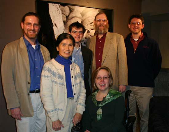 Officers of the Maryland Returned Volunteers, (standing) Joby Taylor, Joanna Allen, Scott Stossel, Hugh Pickens, Chris Seremet, and (seated) Christa Bucks-Camacho pose with Scott after the event.
