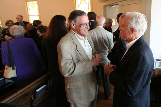 Inside the church Peace Corps Volunteers and Staff like former Peace Corps Director Jack Vaughn (right)  met and remembered the life Peace Corps Architect Warren Wiggins.