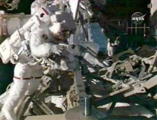 Joseph Acaba Makes First Spacewalk