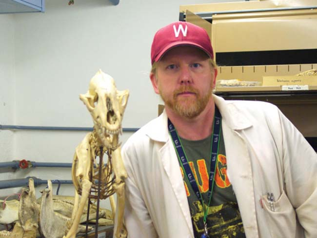 As a researcher at the University of Witwatersrand's Institute for Human Evolution who specializes in extinct carnivores, Morocco and Jordan RPCV Brian Kuhn is especially interested in the latest piece of rock he's been given because he believes it holds the fossilized remains of a saber-toothed cat