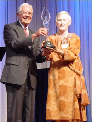 Acting Peace Corps Director and Former President Jimmy Carter Present The Lillian Carter Award to Dr. Catherine Taylor Foster who, at the age of 59, began her two years of service in 1996 as a health Volunteer in Nepal