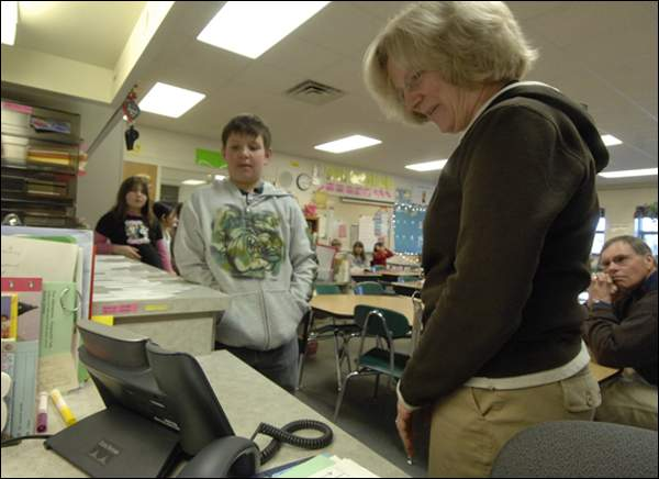 Darlene Cavey and her third-grade students talk via speakerphone Tuesday with her son, Mike, who is a volunteer in the Peace Corps stationed in Turkmenistan in central Asia