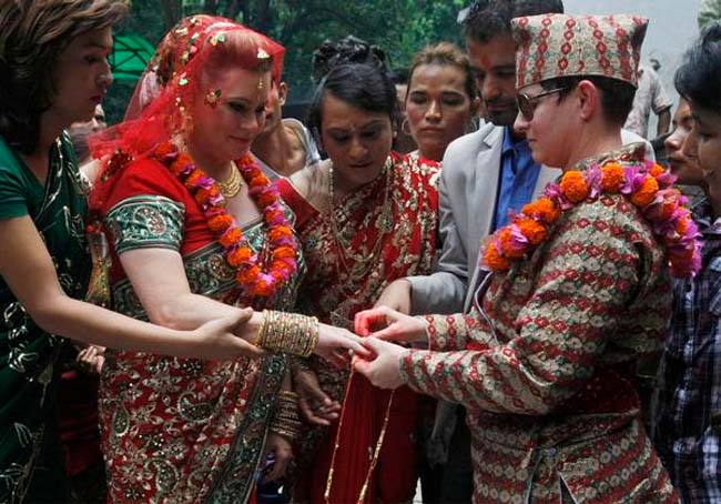 Nepal RPCV Courtney Mitchell marries Sarah Welton in a Hindu Nepalese tradition in the first public lesbian wedding in the Himalayan nation that recently began recognizing gay rights and working to draft laws to end sexual discrimination