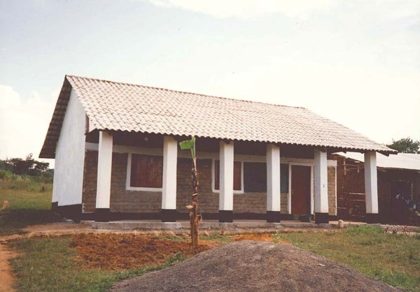"Peace Corps Volunteer Jennifer Monahan designed and built a classroom in Kenya 1987 using ""locally-made appropriate building materials"