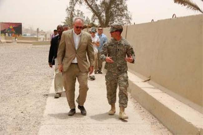 On the day a bomb exploded as his motorcade passed by, the U.S. ambassador to Iraq was touring an American military base to check on the Army's role of supporting civilian reconstruction projects