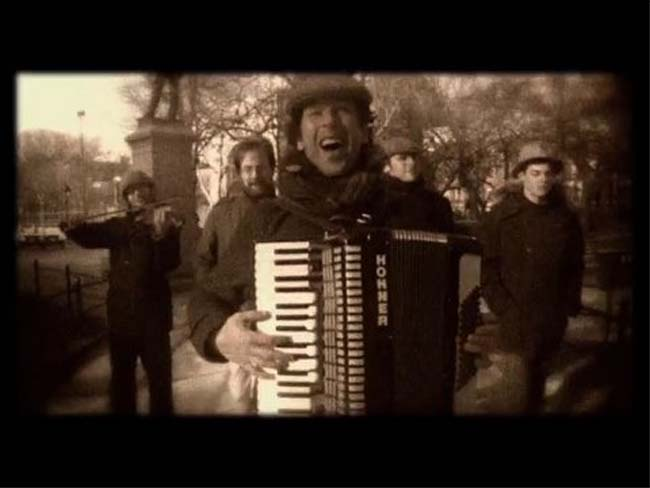 Romania RPCV James Craft plays the accordion in the band, La Strada