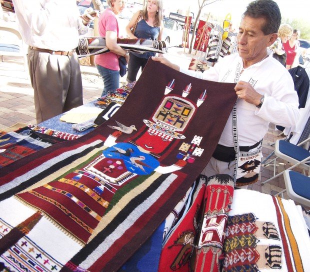 Ecuador RPCV Nathan Miller with friend and weaver Rudy Masaquiza through the grapevine