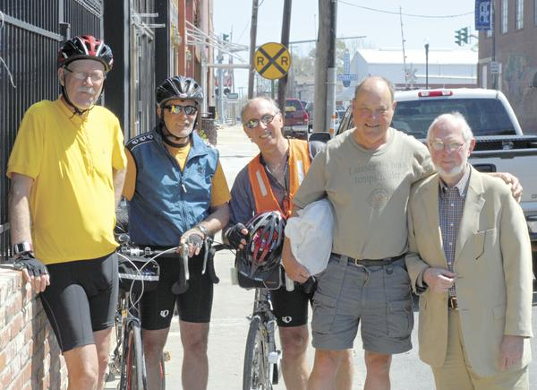Cross-country Bicyclers Ted  Brush,Rich Friedman and Art McMullen served together in the Peace Corps in the Philippines, and the five have been friends for over 45 years