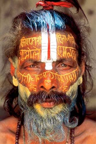 Williams Meyers writes: The practices of the sadhus, the vividly decorated or nude Hindu ascetics in Nepal RPCV Thomas Kelly's striking color portraits, are simply beyond me