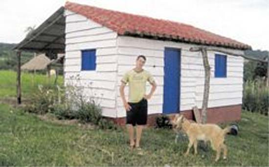 Paraguay Peace Corps Volunteer Will Osterholz has constructed his cement block home -- complete with a tile roof -- himself